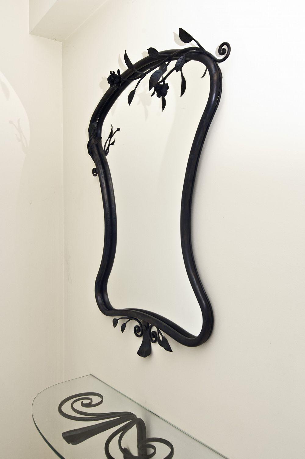 Specchio con cornice in ferro